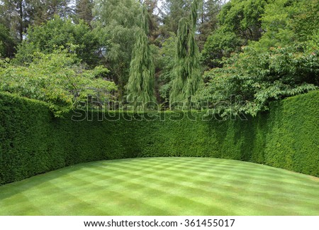 Well Manicured Lawn with a Checkerboard Pattern and a Yew Hedge at Rosemoor, Devon, England, UK - stock photo