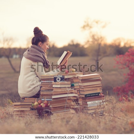 well-read girl - stock photo