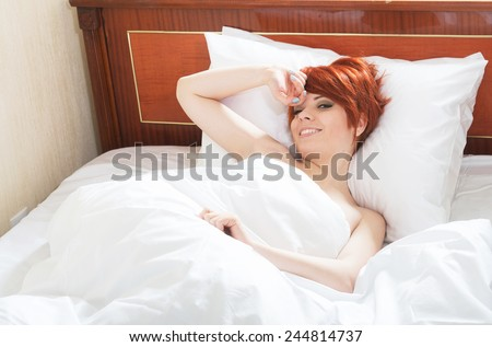 Well-rested girl waking up - stock photo