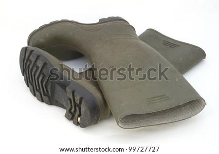 Wellington boots against a plain white background. - stock photo