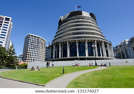 WELLINGTON - FEB 25:The Beehive building - Parliament of NZ in Wellington city on February 25 2013.It is so-called because of its shape is reminiscent of that of a traditional woven form of beehive. - stock photo