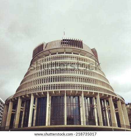 WELLINGTON - SEPTEMBER 8: The Beehive Parliament building under cloudy skies on September 8, 2014 in Wellington, New Zealand. - stock photo