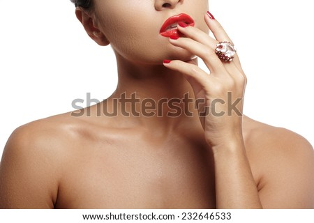 Wellness, cosmetics and chic style. Close-up portrait of sensuality beautiful woman model face with fashion make-up, sexy evening red lips makeup and bright red manicure  - stock photo