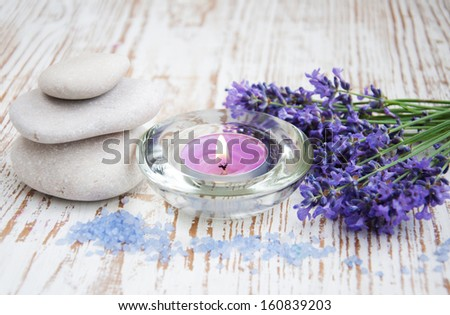 wellness products -  candle, lavender and sea salt - stock photo