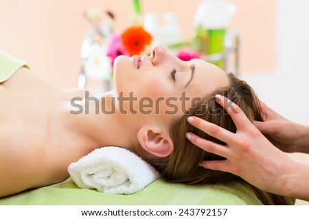 Wellness - woman receiving head or face massage in spa - stock photo