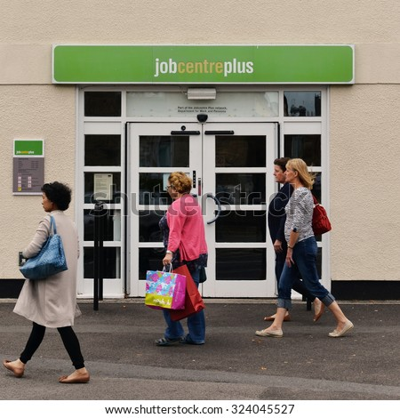 WELLS - AUG 30: People walk past a JobCentre Plus unemployment office in the city centre on Aug 30, 2014 in Wells, UK. The modern welfare state in the UK was founded on the Beveridge Report of 1942. - stock photo