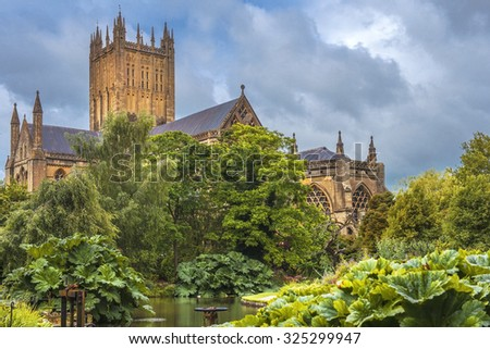 Wells Cathedral (Cathedral Church of Saint Andrew), Wells Abbey and park on sunny day, Somerset, England - stock photo