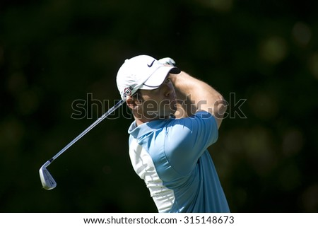 WENTWORTH, ENGLAND. 24 MAY 2009.Paul Casey playing a shot on his way to winning  playing in the final round of the European Tour BMW PGA Championship. - stock photo