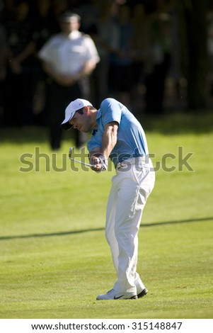 WENTWORTH, ENGLAND. 24 MAY 2009.Paul Casey playing a shot on his way to winning the European Tour BMW PGA Championship. - stock photo