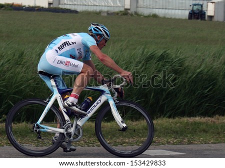 WERVERHOOF, NETHERLANDS - MAY 22: Cylist during cycling race in may 22, 2011 in Werverhoof, The Netherlands.  - stock photo