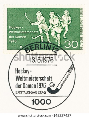 WEST BERLIN - CIRCA 1976: A stamp printed in Germany, shows women's field hockey, Womens World Hockey Championships, circa 1976 - stock photo