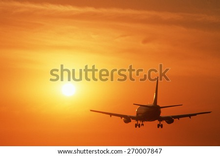 West bound jet departing from Los Angeles International Airport at sunset - stock photo