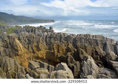 West Coast, New Zealand's main tourist attraction - the spectacular Punakaiki Rocks on a stormy day in Spring. - stock photo