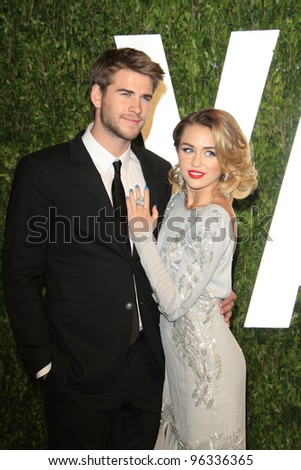 WEST HOLLYWOOD, CA - FEB 26: Miley Cyrus; Liam Hemsworth at the Vanity Fair Oscar Party at Sunset Tower on February 26, 2012 in West Hollywood, California. - stock photo