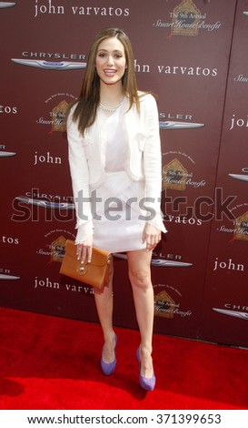 WEST HOLLYWOOD, CALIFORNIA - March 11, 2012. Emmy Rossum at the John Varvatos 9th Annual Stuart House Benefit held at the John Varvatos Boutique, Los Angeles.   - stock photo