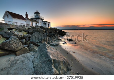 West Point lighthouse at Discovery park Seattle at dusk - stock photo