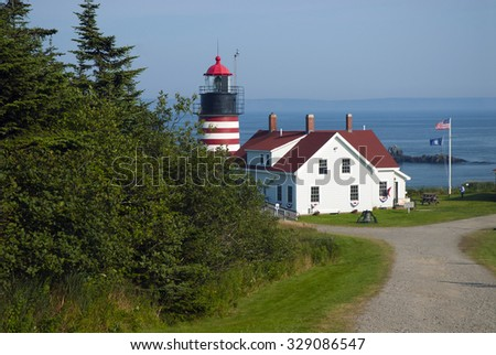 West Quoddy Head Lighthouse overlooks the Bay of Fundy on the Maine border. - stock photo