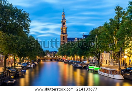 Westerkerk on the Prinsengracht Canal in Amsterdam at Twilight, the Netherlands - stock photo