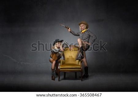 western gun shooting concept, dark background - stock photo