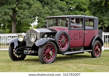 WESTERNHANGER, UK - AUGUST 16: A vintage Rolls Royce limousine stands on static display in the public viewing area at the War & Peace show on August 16, 2013 in Westernhanger - stock photo