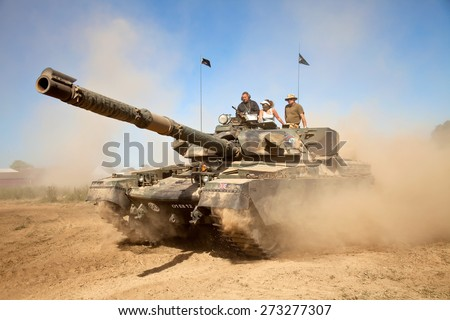 WESTERNHANGER, UK - JULY 19: An ex British army Chieftain MBT tank is driven around the main arena for the public to watch at the W&P show on July 19, 2013 in Westernhanger - stock photo