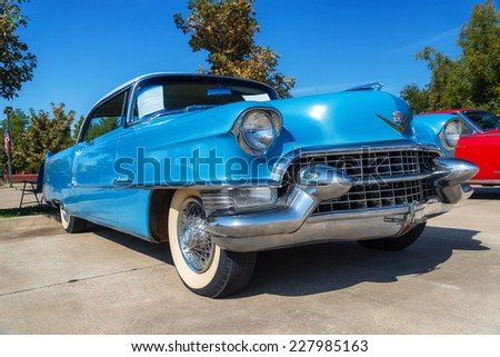 WESTLAKE, TEXAS - OCTOBER 18, 2014: A 1955 Cadillac Coupe DeVille is on display at the 4th Annual Westlake Classic Car Show. Front side view. - stock photo