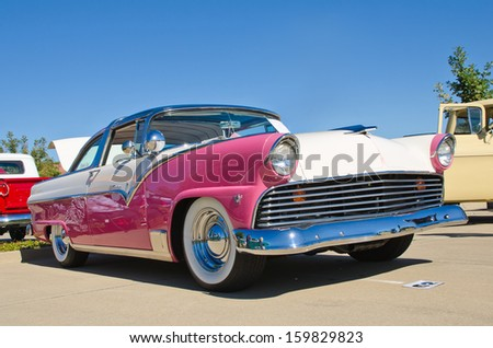 WESTLAKE, TEXAS - OCTOBER 19: A 1955 Ford Crown Victoria 2dr hardtop is on display at the 3rd Annual Westlake Classic Car Show on October 19, 2013 in Westlake, Texas. - stock photo