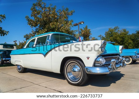 WESTLAKE, TEXAS - OCTOBER 18, 2014: A 1955 Ford Fairlane is on display at the 4th Annual Westlake Classic Car Show. Front side view. - stock photo
