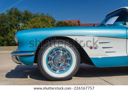 WESTLAKE, TEXAS - OCTOBER 18, 2014: A turquoise 1959 Chevrolet Corvette Convertible is on display at the 4th Annual Westlake Classic Car Show. Closeup of front side view. - stock photo