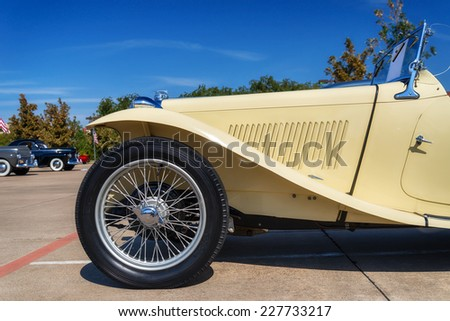 WESTLAKE, TEXAS - OCTOBER 18, 2014: A yellow 1947 MG TC Roadster is on display at the 4th Annual Westlake Classic Car Show. Closeup of front side view. - stock photo