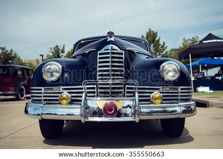 WESTLAKE, TEXAS - OCTOBER 17, 2015: Front view of a dark blue 1947 Packard Custom Coupe classic car. - stock photo