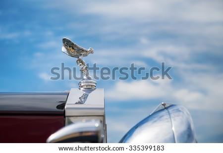 WESTLAKE, TEXAS - OCTOBER 17, 2015: Hood ornament of a 1937 Rolls Royce Park Ward Limousine classic car against blue sky.  - stock photo