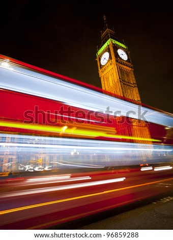 Westminster Bridge in London at night with Big Ben and bus - stock photo