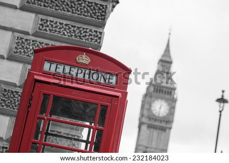 Westminster phone box in color with the Palace of Westminster in black and white in the background. - stock photo