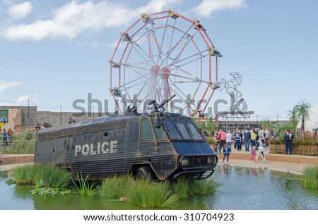 WESTON-SUPER-MARE, UK - AUGUST 26, 2015:  A former crowd control police van with water cannon from Northern Ireland now converted to a fountain.  Weston-Super-Mare. - stock photo
