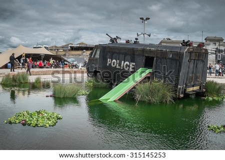 WESTON-SUPER-MARE, UK - SEPTEMBER 3 2015: A police riot van in Water Cannon Creek at Banksy's Dismaland Bemusement Park. A five week show in the seaside town of Weston-Super-Mare. - stock photo