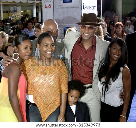 WESTWOOD, CA - JULY 07, 2004: Will Smith, Jada Pinkett Smith and Jaden Smith at the World premiere of 'I, Robot' held at the Mann Village Theatre in Westwood, USA on July 7, 2004. - stock photo