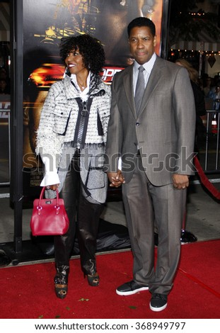 "WESTWOOD, CALIFORNIA - October 26, 2010. Denzel Washington and Pauletta Washington at the Los Angeles premiere of ""Unstoppable"" held at the Westwood Village Theater, Los Angeles. - stock photo"