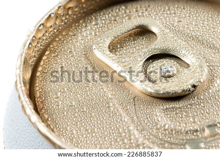 wet aluminum can with drink, close-up of top - stock photo