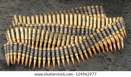 Wet Ammunition Bullets on a Rainy Day. - stock photo