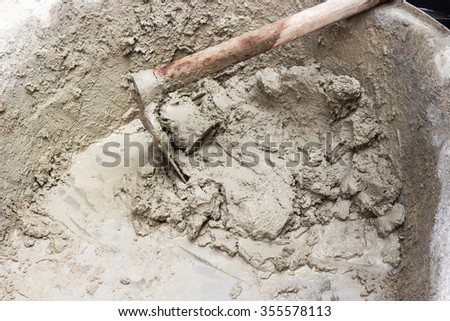 Wet cement mixed for building at construction site - stock photo