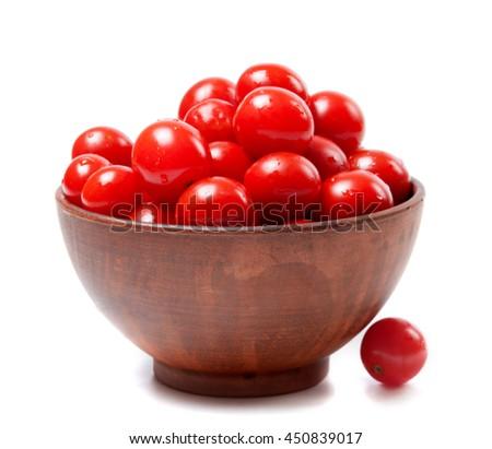Wet cherry tomato in ceramic bowl. Isolated on white background. - stock photo