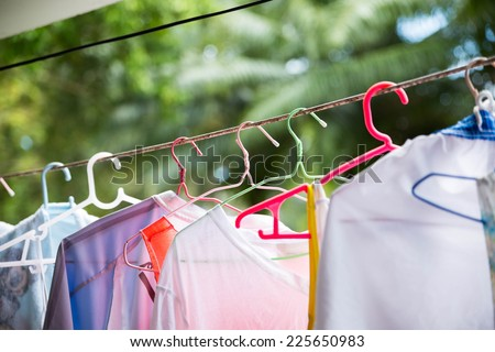 Wet clothes outside the house. - stock photo