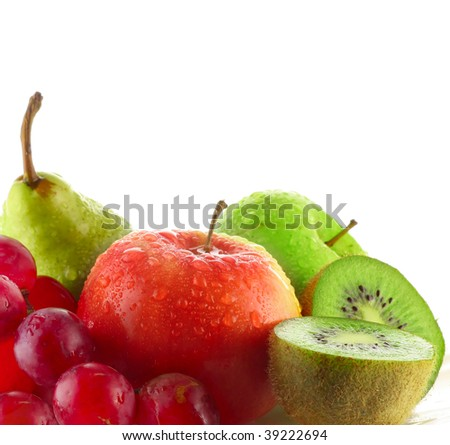Wet fruits on white plate - stock photo