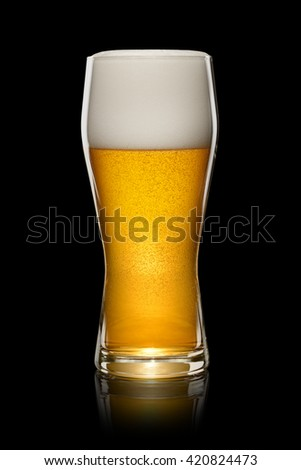 Wet Glass of fresh beer isolated on black background. With clipping path - stock photo