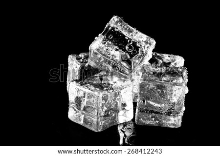 Wet ice cubes on black background. Selective focus. - stock photo