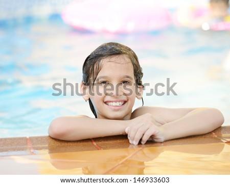 Wet kids having happy time on summer swimming pool - stock photo