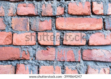 wet layer concrete on brick wall background - stock photo