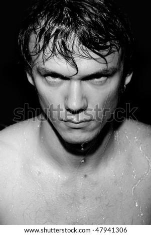 wet man on a dark background - stock photo