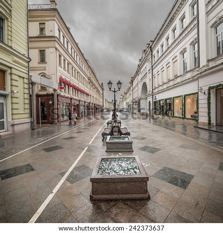 Wet morning city street at snowy weather time. - stock photo